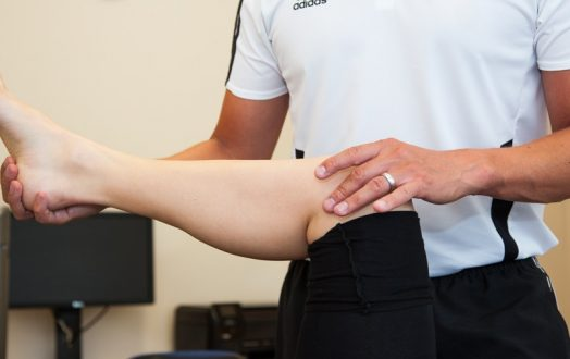 An image showing joint mobilisations being conducted by a senior physiotherapist.